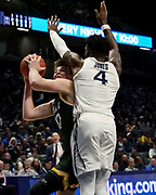 Kyle Young (12) of Siena looks to shoot past Tyrique Jones (4) of Xavier during an NCAA college basketball game, Friday, Nov. 8, 2019, at the Cintas Center in Cincinnati, OH. Xavier defeated Siena 81-63. (Jason Whitman/Image of Sport)