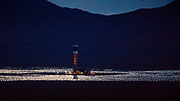 One of the boiler towers at the Ivanpah Solar Electric Generating System cools down after sundown. The power plant is a concentrated solar thermal plant. Almost 350.000 mirrors focus the sun on three boiling towers, generating up to 392 megawatts. The huge plant dominate the landscape in the Mojave desert some 40 miles south of Las Vegas.
