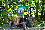 Rusty old farm tractor in Devon, Southern England, UK