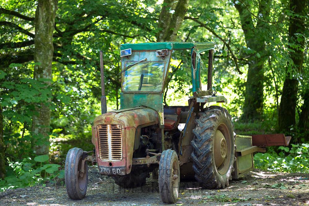 Rusty old farm tractor in Devon, Southern England, UK