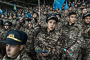Army cadets look on as FC Astana play against Greek side Olympiacos in the group stage of the Europa league, in the Astana Arena, in Astana, Kazakhstan. <br /> FC Astana have become regular competitors in European football during recent years. Army cadets have their own section in the stadium where they help generate noise in support of the team.