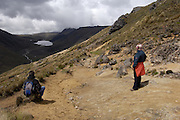 Achupallas - Tuesday, Jan 01 2008: Lorna Brooks (on right) and guide, Luis, look across to Laguna Culebrilla in the valley below. This was the second day of the three day trek from Achupallas to Ingapirca. (Photo by Peter Horrell / http://www.peterhorrell.com)