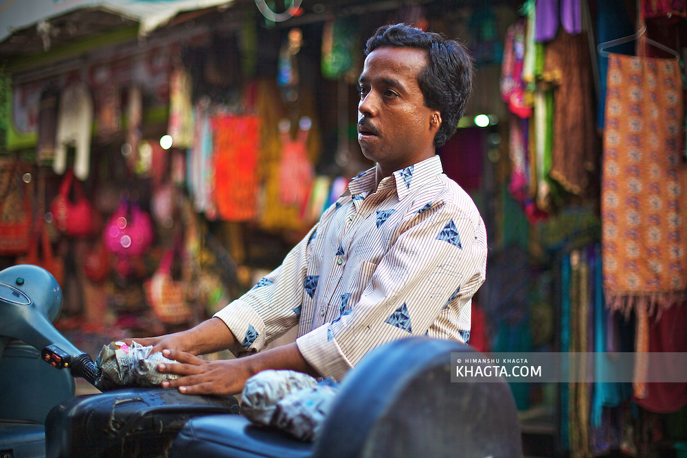 A local from Pushkar, Rajasthan waiting in the market.<br /> <br /> Holy town of Pushkar, 14 kms from Ajmer is famous for its annual camel fair held in the autumn. With a scared lake, old temples and roof top restaurants, its a major tourist attraction attracting mostly foreign tourists. Pushkar also offers a great variety of delicious food. The town that got famous by its colorful camel fair is a very old religious place for Hindu pilgrims.
