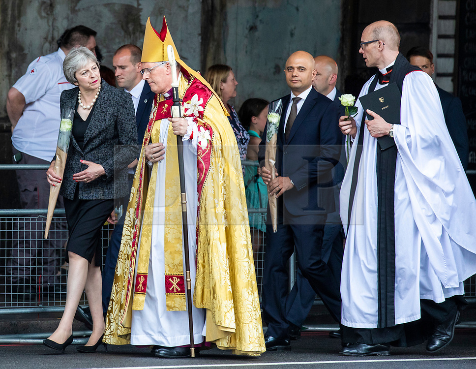 © Licensed to London News Pictures. 03/06/2018. London, UK. Prime Minister Theresa May (L), Bishop of Southwark Christopher Chessun (2-L) and Home Secretary Sajid Javid (3-L) walk from Southwark Cathedral to London Bridge to lay flowers and observe a minute's silence to mark the first anniversary of the London Bridge and Borough Market terror attack. Photo credit: Rob Pinney/LNP