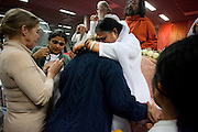 Een bezoeker ondergaat de darshan, oftewel omhelzing van Amma. In de Expo in Houten is Mata Amritanandamayi, beter bekend als Amma of 'hugging mother', aanwezig om mensen te omhelzen en te inspireren. Het driedaags benefiet in Houten is het grootste spirituele festival in Nederland en zal naar verwachting 15.000 bezoekers trekken.<br /> <br /> A visitor is receiving the darshan from Amma. In the Expo in Houten people are gathering to get a darshan, or hug, by  Mata Amritanandamayi, also known as Amma or 'hugging mother'. Amma is travelling through the world to hug people for inspiring them to make a better world. Amma is one of the twelve most influence spiritual leaders of the world. The event in Houten lasts for three days and is the biggest spiritual event of The Netherlands.