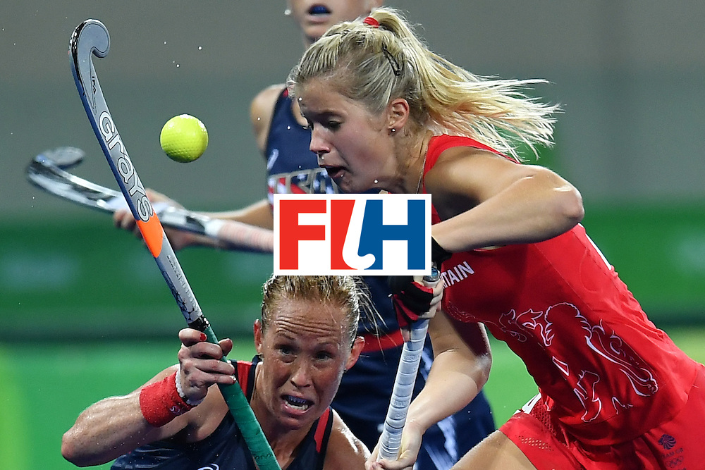 Great Britain's Sophie Bray and USA's Lauren Crandall (L) vie during the women's field hockey Britain vs the USA match of the Rio 2016 Olympics Games at the Olympic Hockey Centre in Rio de Janeiro on August, 13 2016. / AFP / MANAN VATSYAYANA        (Photo credit should read MANAN VATSYAYANA/AFP/Getty Images)