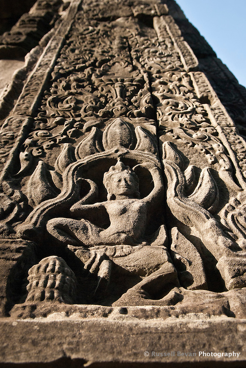 One of many carvings of women dancing at The Bayon temple in the walled city of Angkor Thom, Siem Reap, Cambodia