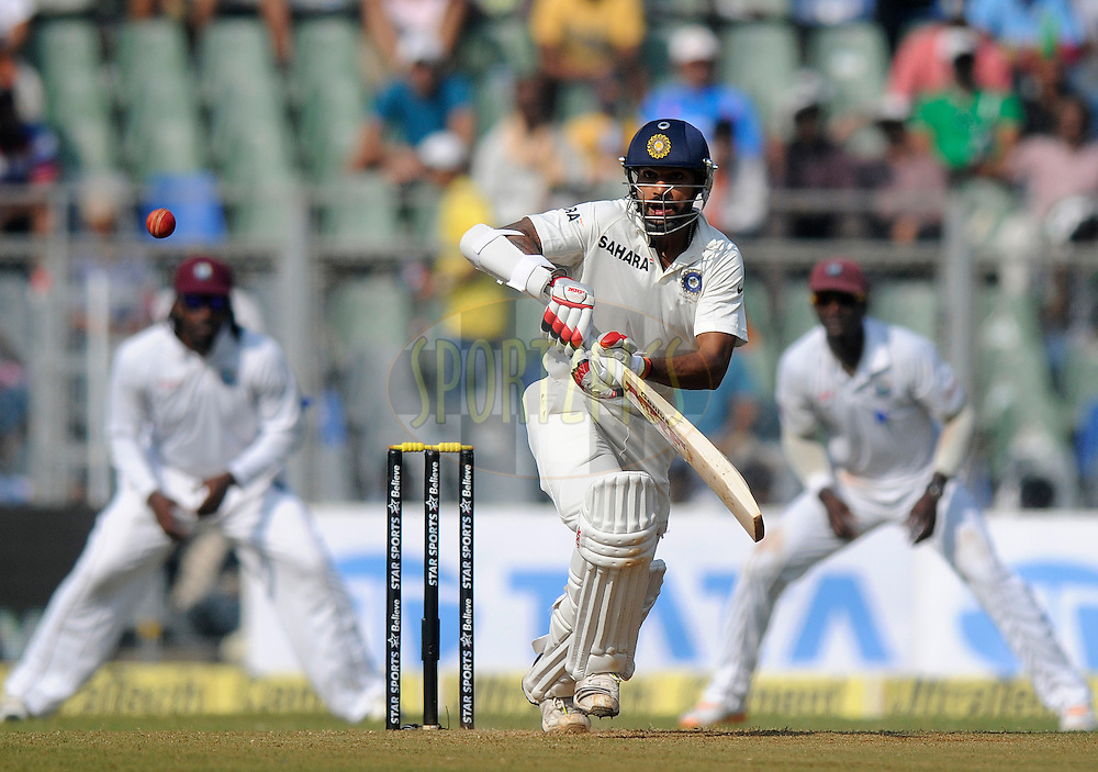 Shikhar Dhawan of India bats during day one of the second Star Sports test match between India and The West Indies held at The Wankhede Stadium in Mumbai, India on the 14th November 2013<br /> <br /> This test match is the 200th test match for Sachin Tendulkar and his last for India.  After a career spanning more than 24yrs Sachin is retiring from cricket and this test match is his last appearance on the field of play.<br /> <br /> Photo by: Pal PIllai - BCCI - SPORTZPICS<br /> <br /> Use of this image is subject to the terms and conditions as outlined by the BCCI. These terms can be found by following this link:<br /> <br /> http://sportzpics.photoshelter.com/gallery/BCCI-Image-Terms/G0000ahUVIIEBQ84/C0000whs75.ajndY