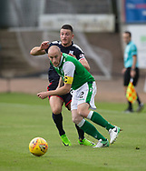27th August 2017, Dens Park, Dundee, Dundee; Scottish Premier League football, Dundee versus Hibernian; Hibernian's David Gray and Dundee's Randy Wolters