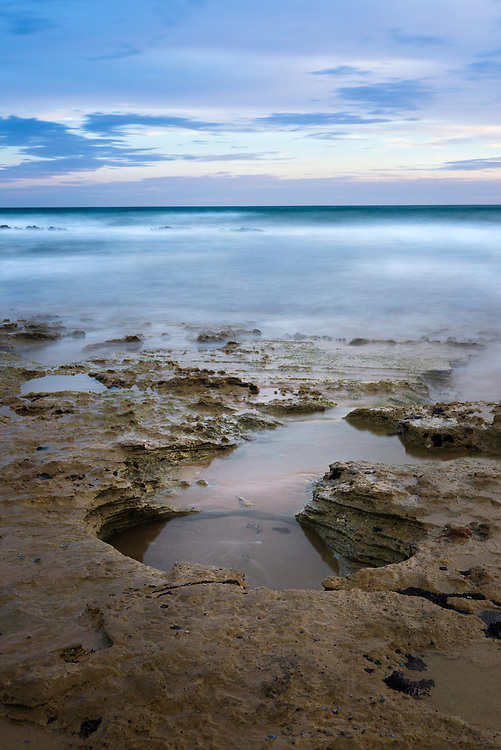 Rock pools at dusk at Point Roadnight, Australia