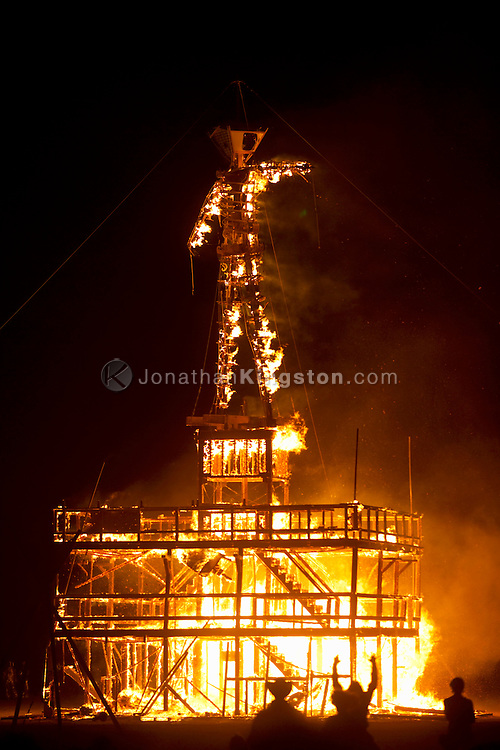"BLACK ROCK CITY, NV:  ""The Man"" burns in Black Rock City, Nevada.  The burning of the man is the focal point of the weeklong event and where the event derives its name."