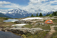Big Agnes tent in backcountry campsite. Yellow Aster Butte Basin, Mount Baker Wilderness. Mount Shuksan is in the distance. North Cascades Washington