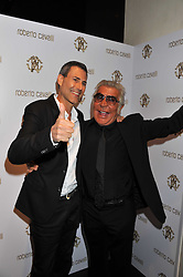 Left to right, URI GELLER and ROBERTO CAVALLI  at a party hosted by Roberto Cavalli to celebrate his new Boutique's opening at 22 Sloane Street, London followed by a party at Battersea Power Station, London SW8 on 17th September 2011.