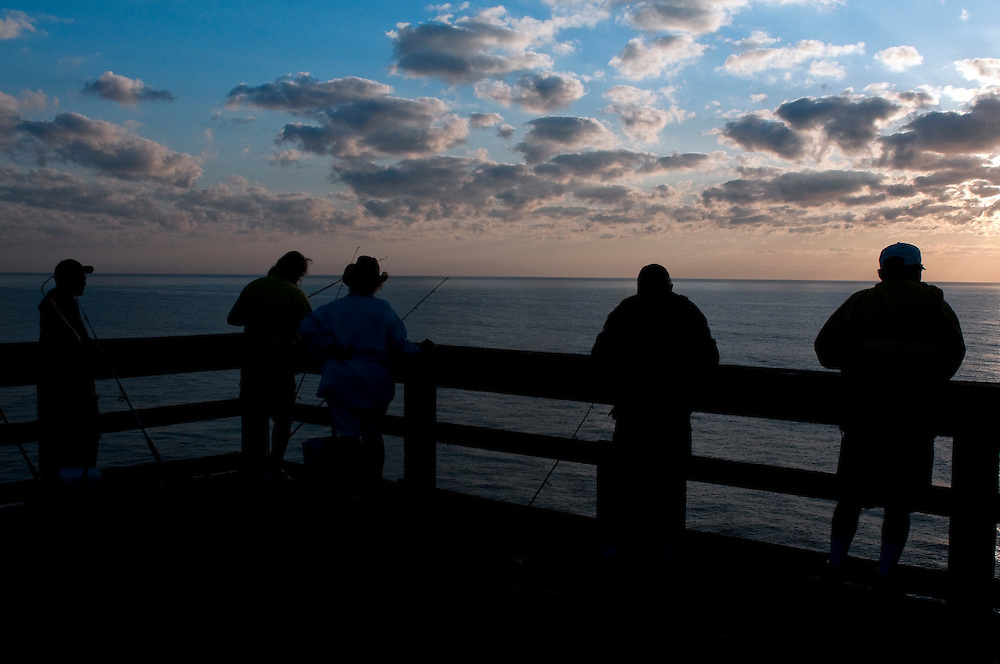Group of people fishing in the morning from the wharf