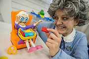Sarah Davies represents the Granny from TOMY's Greedy Granny Game and acts out - the biscuit stealing game The annual London Toy Fair, the trade show for the toy and games industry, takes place at Olympia.