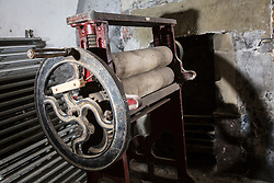 © Licensed to London News Pictures. 23/06/2015. Leeds, UK. Rarely seen hidden Tudor tunnels & cellars of Temple Newsam house in Yorkshire. Picture shows an old mangle that can be found in the cellars. Temple Newsam is famous as the birth place of Lord Darnley, notorious husband of Mary Queen of Scots. The Tudor-Jacobean mansion is set in 1,500 acres with grounds landscaped by Capability Brown. Photo credit : Andrew McCaren/LNP