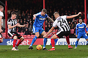 Notts County forward Jonathan Stead(30) under attack from Grimsby Town defender Harry Davis(24) during the EFL Sky Bet League 2 match between Grimsby Town FC and Notts County at Blundell Park, Grimsby, United Kingdom on 22 December 2018.