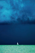 Storm Clouds over White Sailboat - Fort Myers Beach, Florida