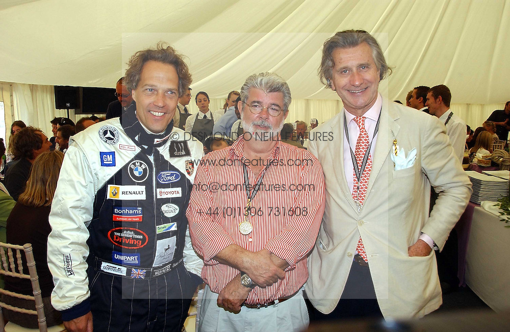 """Left to right, The EARL OF MARCH, GEORGE LUCAS and ARNAUD BAMBERGER at the Goodwood Festival of Speed on 9th July 2006.  Cartier sponsored the """"Style Et Luxe' for vintage cars on the final day of this annual event at Goodwood House, West Sussex and hosted a lunch.<br /><br />NON EXCLUSIVE - WORLD RIGHTS"""