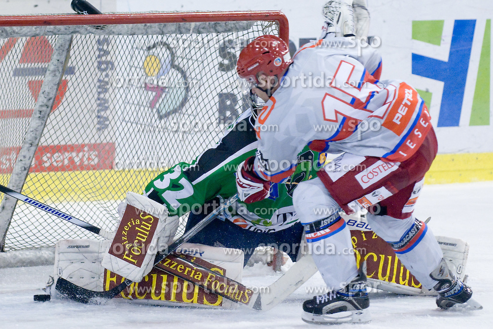 Mickel Bayrack (HK Acroni Jesenice, #15) vs Jan Chabera (HDD Tilia Olimpija, #32) during ice-hockey match between HDD Tilia Olimpija and HK Acroni Jesenice in 41st Round of EBEL league, on Januar 23, 2011 at Hala Tivoli, Ljubljana, Slovenia. (Photo By Matic Klansek Velej / Sportida.com)