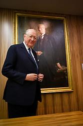 © Licensed to London News Pictures. 22/02/2013. London, UK. Bruno Schroder pictured at his London office in front of a portrait of Baron Bruno Schroder. The billionaire head of his family's investment bank, has passed away aged 86. Photo credit: Ben Cawthra/LNP