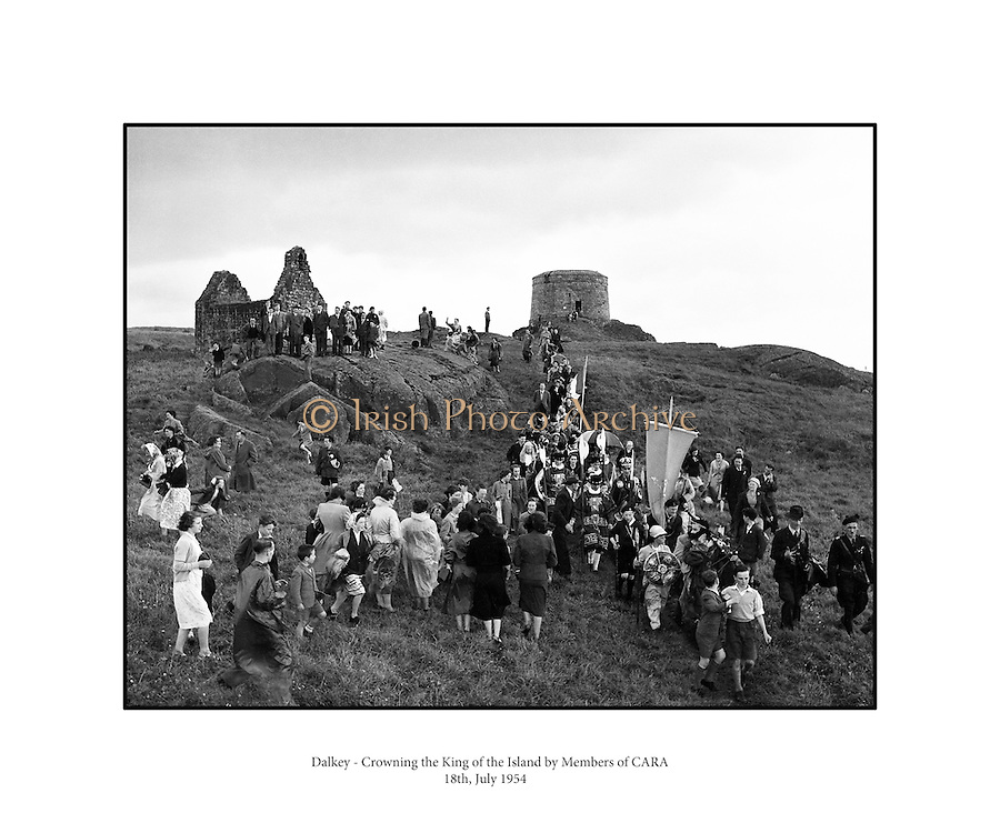"""Dalkey - Crowning the King of the Island by Members of CARA.18/07/1954..In the late 18th century a mock title of """"King of Dalkey"""" was created to poke fun at the pomposities of the government of the day. It is still revived occasionally for fun but was quoshed around the time of the 1798 rising when it was seen as seriously seditious instead of funny by the government of his Britannic majesty (pomposity never goes out of fashion :) The full title was King of Dalkey, Emperor of the Muglins, Prince of the Holy Island of Magee, Baron of Bulloch, Seigneur of Sandycove, Defender of the Faith and Respector of All Others, Elector of Lambay and Ireland's Eye, and Sovereign of the Most Illustrious Order of the Lobster and Periwinkle....Read more: http://www.virtualtourist.com/travel/Europe/Ireland/County_Dublin/Dalkey-296187/Things_To_Do-Dalkey-TG-C-1.html#themes=31&page=1&tgCount=0#ixzz1mw4Bsvus."""