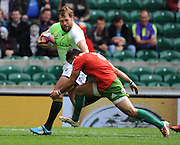 LONDON, ENGLAND - Saturday 10 May 2014, Frankie Horne of South Africa is about to be tackled by Manuel Raposo of Portugal during the match between South Africa and Portugal at the Marriott London Sevens rugby tournament being held at Twickenham Rugby Stadium in London as part of the HSBC Sevens World Series.<br /> Photo by Roger Sedres/ImageSA