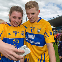 Aoife Anderson from Ruan getting a selfie with Podge Collins at the final whistle
