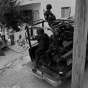 Heavily armed Civil Police patrol through Colonia Independencia in Monterrey, Mexico, during the Mexican General Election. Monterrey is a vital hub for the U.S.-Mexico border and one of the richest and most violent cities in Mexico..(Credit Image: © Louie Palu/ZUMA Press).July 2012