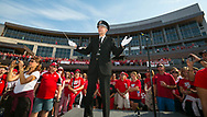 Michael Leckrone, director of the UW Marching Band, directs the band as fans watch at Badger Bash at Union South in 2014.