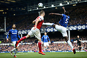 Everton defender Kurt Zouma (5) clears from Arsenal defender Shkodran Mustafi (20) during the Premier League match between Everton and Arsenal at Goodison Park, Liverpool, England on 7 April 2019.