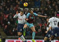 Football - 2018 / 2019 Premier League - Tottenham Hotspur vs. Burnley<br /> <br /> Toby Alderweireld (Tottenham FC) and Ashley Barnes (Burnley FC) contest the high ball at Wembley Stadium.<br /> <br /> COLORSPORT/DANIEL BEARHAM