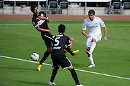 Swansea city's Danny Graham ® hits a shot just wide of goal. Pre-season friendly match, Swansea city v FC Stuttgart at the Liberty Stadium in Swansea, South Wales on Saturday 11th August 2012. pic by Andrew Orchard, Andrew Orchard sports photography,