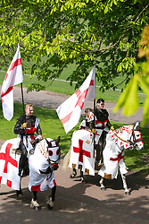 © Licensed to London News Pictures. 23/04/2015. Nottingham, UK. The Nottingham St George's parade took part today. The parade met in Forest Recreation Ground. An estimated two hundred people with trucks playing patriotic music and horses dressed in flags made their way along the streets into the City Centre. The knights set of from Forest Recreation Ground. Photo credit : Dave Warren/LNP
