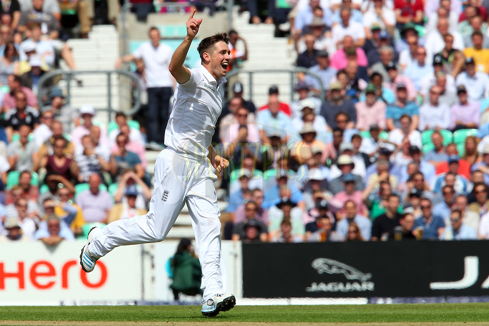 Chris Woakes of England celebrates the wicket of Murali Vijay of India during day one of the fifth Investec Test Match between England and India held at The Kia Oval cricket ground in London, England on the 15th August 2014<br /> <br /> Photo by Ron Gaunt / SPORTZPICS/ BCCI