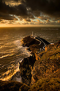 South Stack lighthouse, Holy Island, Anglesey, Ynys Môn. c1809 - Electrified in 1938 - Automated in 1984. 440 steps lead from the 200ft cliff top down to the bridge across the gorge below.