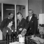26/09/1962<br /> 09/26/1962<br /> 26 September 1962<br /> Opening of Earl Bottlers Ltd. at South Earl Street, Dublin. Minister for Justice Charles Haughey opened the new premises that produced Sandyman port. Picture shows Mr Haughey (centre)  being given a tour of the plant by Mr W. Campbell, (left), Director of Earl Bottlers.