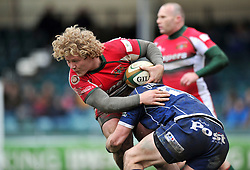 Jared Saunders (Plymouth) is tackled in possession - Photo mandatory by-line: Patrick Khachfe/JMP - Tel: Mobile: 07966 386802 23/02/2014 - SPORT - RUGBY UNION - Memorial Stadium, Bristol - Bristol Rugby v Plymouth Albion - Greene King IPA Championship.