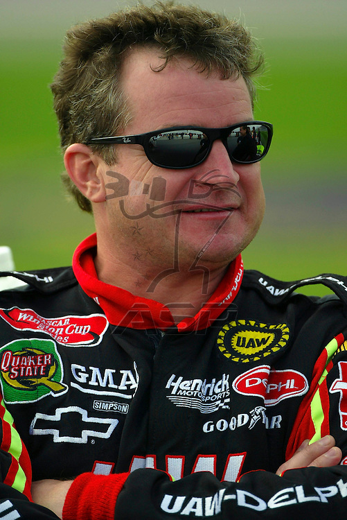 Joe Nemechek waits his turn to go out on the track before a practice session for the Banquet 400 NASCAR Winston Cup race at the Kansas Speedway in Kansas City, KS.