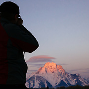 Doug Wachob shoots photos of sunrise over Mount Moran in Grand Teton National Park.