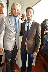 Left to right, OWAIN WALBYOFF and F1 driver DANIEL RICCIARDO at the 2014 Hennessy Gold Cup at Newbury Racecourse, Newbury, Berkshire on 29th November 2014.  The Gold Cup was won by Many Clouds ridden by Leighton Aspell,