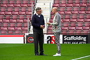 Heart of Midlothian manager Craig Levein chats wth Gary McAllister, assistant manager of Rangers FC on the pitch before the Ladbrokes Scottish Premiership match between Heart of Midlothian and Rangers FC at Tynecastle Park, Edinburgh, Scotland on 20 October 2019.