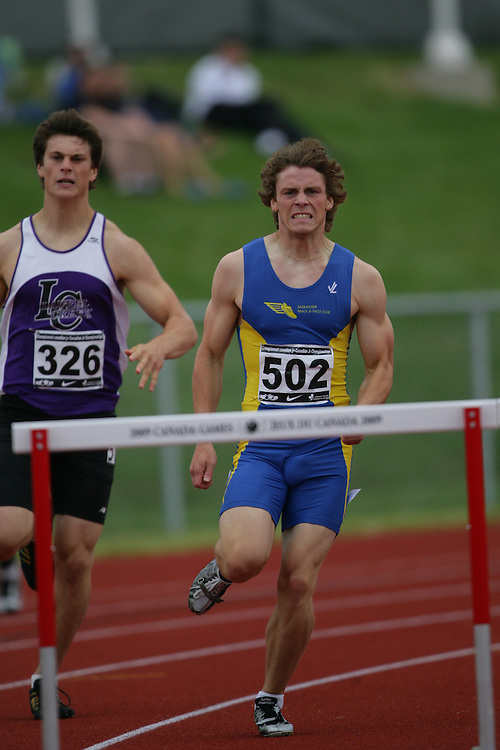 (Charlottetown, Prince Edward Island -- 20090718) Andrew Arndt of Saskatoon TF Club competes in the 400m hurdles semifinals at the 2009 Canadian Junior Track & Field Championships at UPEI Alumni Canada Games Place on the campus of the University of Prince Edward Island, July 17-19, 2009.  Geoff Robins / Mundo Sport Images ..Mundo Sport Images has been contracted by Athletics Canada to provide images to the media.