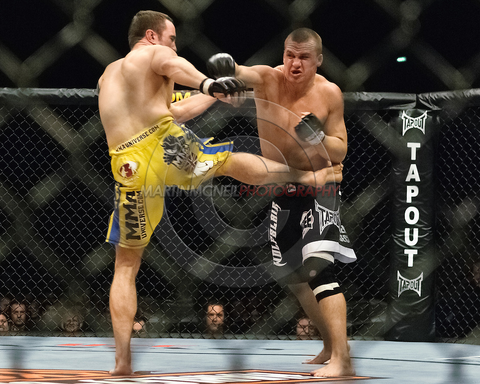 """NEWCASTLE, ENGLAND, UNITED KINGDOM, JANUARY 19 2008: Paul Taylor (left) and Paul Kelly trade blows during """"UFC 80: Rapid Fire"""" inside the Metro Radio Arena in Newcastle, England on January 19, 2008."""