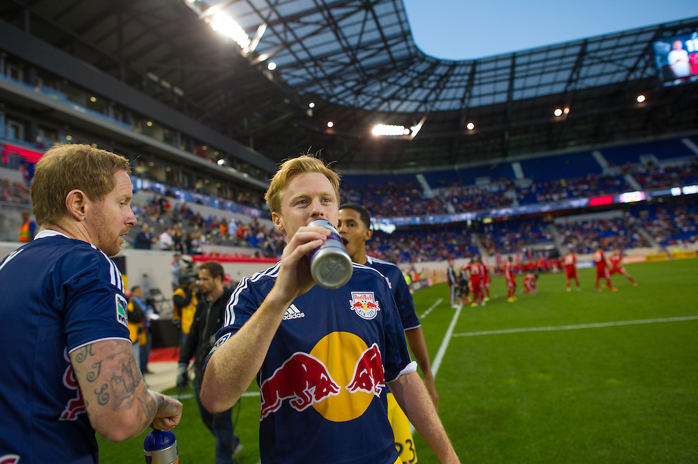 HARRISON, NJ - SEPTEMBER 14:  Dax McCarty #11 of New York Red Bulls has a drink of water before the game against the Toronto FC at Red Bulls Arena on September 14, 2013. (Photo By: Rob Tringali)