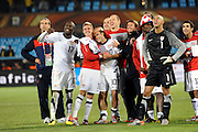 June 23, 2010; Pretoria, SOUTH AFRICA; USA midfielder Landon Donovan (10) hugs Stuart Holden (11) as they celebrate with teammates watching the video replay of the winning goal against Algeria during Group C play in the 2010 World Cup at Loftus Versfeld Stadium.