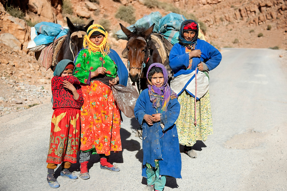 Two women with their children and two mules in the Todra mountains, Morocco.
