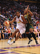 Aug 20, 2010; Phoenix, AZ, USA; Phoenix Mercury forward Kara Braxton drives the ball against Seattle Storm forward Le'coe Willingham during the first half in at US Airways Center.  Mandatory Credit: Jennifer Stewart-US PRESSWIRE