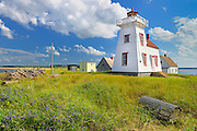 Lighthouse and lobster traps<br /> North Rustico Harbour<br /> Prince Edward Island <br /> Canada