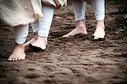 Ascetic monks of the Shingo sect of Buddhism cool their feets after taking part in hiwatari fire-walking ritual in Takao, west of Tokyo, Japan on Sunday 09 March  2009.